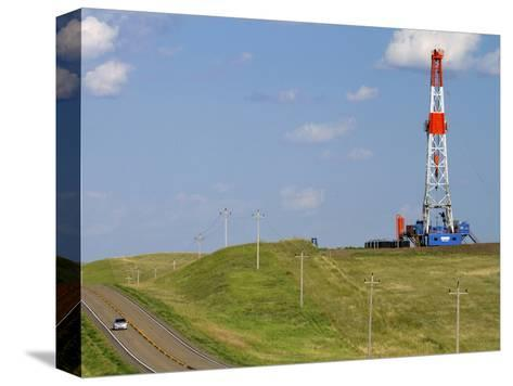 Patterson Uti Oil Drilling Rig Along Highway 200 West of Killdeer, North Dakota, USA-David R^ Frazier-Stretched Canvas Print