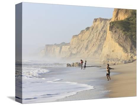 Kids Playing on Beach, Santa Cruz Coast, California, USA-Tom Norring-Stretched Canvas Print