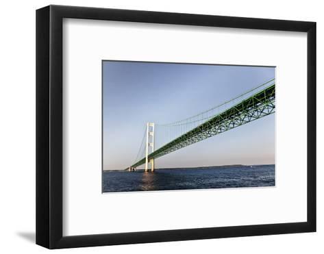 Sailing under the Mackinac Bridge in Mackinac Island, Michigan, USA-Joe Restuccia III-Framed Art Print
