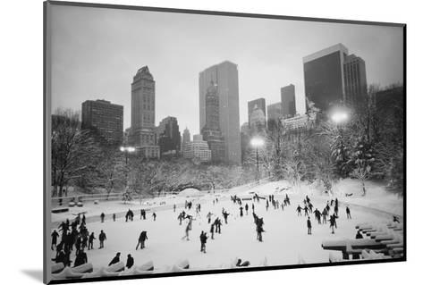 USA, New York, New York City, Skaters at the Wollman Rink-Walter Bibikow-Mounted Photographic Print