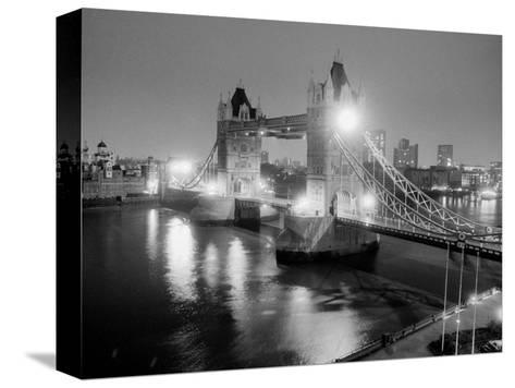 A View of Tower Bridge on the River Thames Illuminated at Night in London, April 1987--Stretched Canvas Print