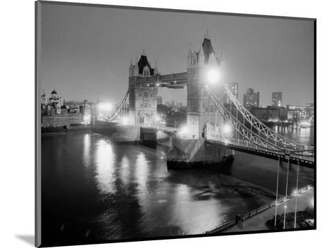 A View of Tower Bridge on the River Thames Illuminated at Night in London, April 1987--Mounted Photographic Print
