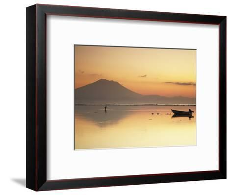 Fisherman Standing in Sea with Mount Agung in the Background, Sanur, Bali, Indonesia-Ian Trower-Framed Art Print