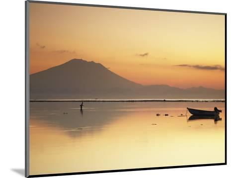Fisherman Standing in Sea with Mount Agung in the Background, Sanur, Bali, Indonesia-Ian Trower-Mounted Photographic Print