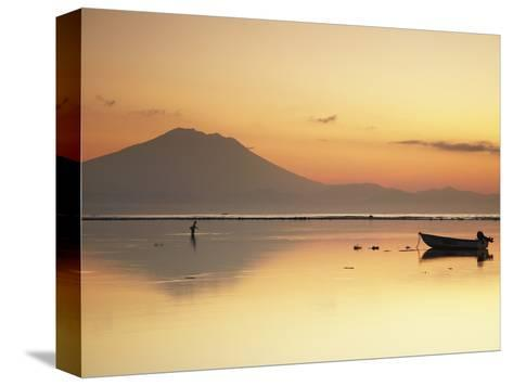 Fisherman Standing in Sea with Mount Agung in the Background, Sanur, Bali, Indonesia-Ian Trower-Stretched Canvas Print