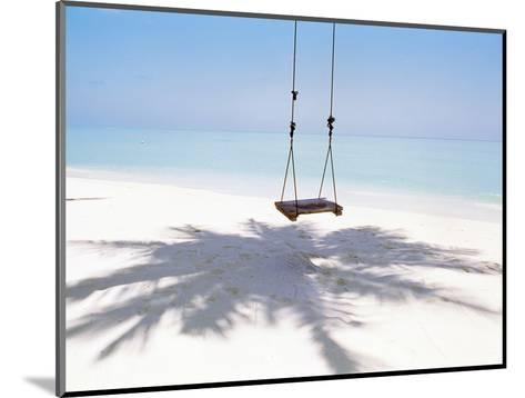 Beach Swing And Shadow of Palm Tree on Sand--Mounted Photographic Print