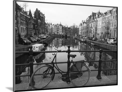 Black and White Imge of an Old Bicycle by the Singel Canal, Amsterdam, Netherlands, Europe-Amanda Hall-Mounted Photographic Print