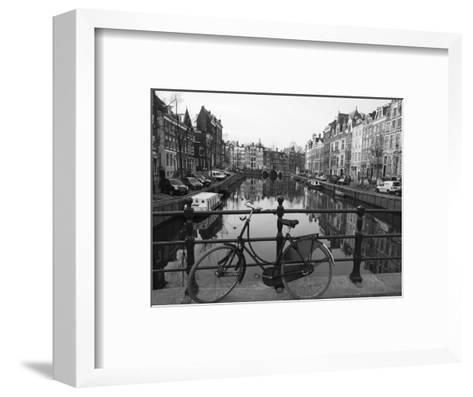 Black and White Imge of an Old Bicycle by the Singel Canal, Amsterdam, Netherlands, Europe-Amanda Hall-Framed Art Print