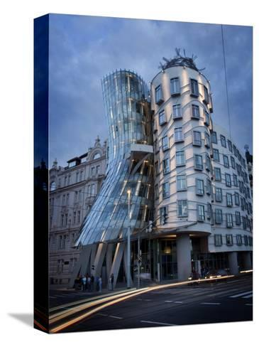 Dancing House (Fred and Ginger Building), by Frank Gehry, at Dusk, Prague, Czech Republic-Nick Servian-Stretched Canvas Print