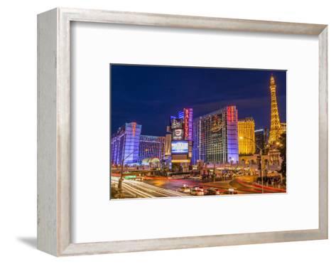 Neon Lights on Las Vegas Strip at Dusk with Car Headlights Leaving Streaks of Light-Eleanor Scriven-Framed Art Print