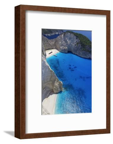 Navagio Beach and Shipwreck at Smugglers Cove on the Coast of Zakynthos-Sakis Papadopoulos-Framed Art Print