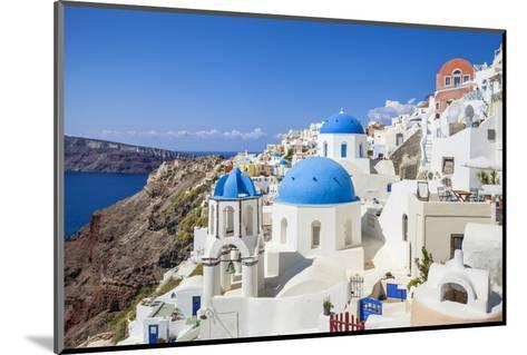 Greek Church with Three Blue Domes in the Village of Oia-Neale Clark-Mounted Photographic Print