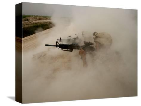 US Marines Return Fire on Taliban Positions Near the Town of Garmser in Afghanistan--Stretched Canvas Print