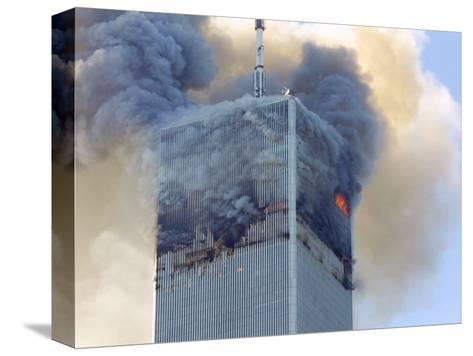 Fire and Smoke Billows from the North Tower of New York's World Trade Center September 11, 2001--Stretched Canvas Print