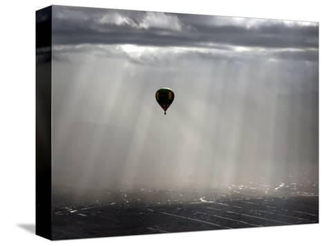 A Lone Balloon Drifts Near the Foothills of Albuquerque, N.M.--Stretched Canvas Print