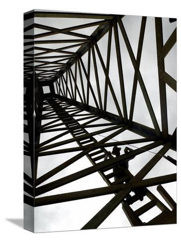 A Reenactor is Silhouetted Inside a Replica of the Spindletop Oil Derrick--Stretched Canvas Print