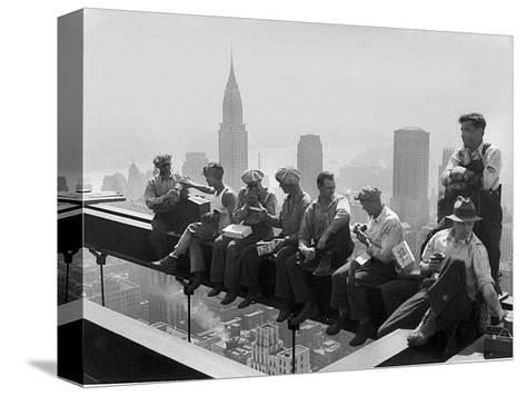 Construction Workers Take a Lunch Break on a Steel Beam Atop the RCA Building at Rockefeller Center--Stretched Canvas Print