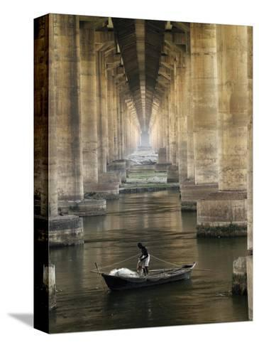 Fisherman Casts His Net in the River Ganges on the Outskirts of Allahabad, India--Stretched Canvas Print