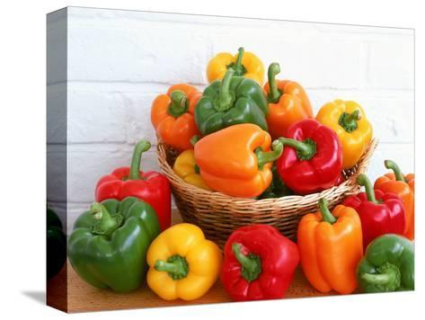 Sweet Peppers in and Around Basket-David Ball-Stretched Canvas Print