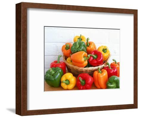 Sweet Peppers in and Around Basket-David Ball-Framed Art Print