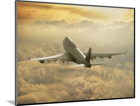 Jumbo Jet Above Clouds at 35,000 Feet-Peter Walton-Mounted Photographic Print