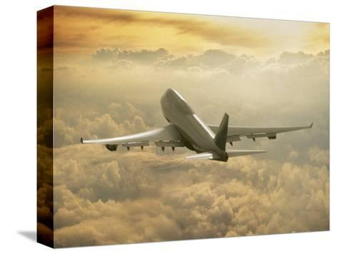 Jumbo Jet Above Clouds at 35,000 Feet-Peter Walton-Stretched Canvas Print