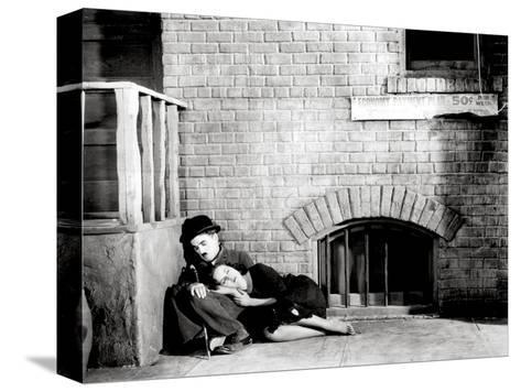 "Charlie Chaplin, Paulette Goddard. ""The Masses"" 1936, ""Modern Times"" Directed by Charles Chaplin--Stretched Canvas Print"