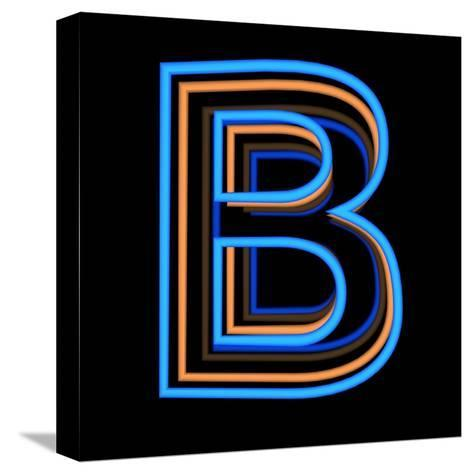 Glowing Letter B Isolated On Black Background-Andriy Zholudyev-Stretched Canvas Print