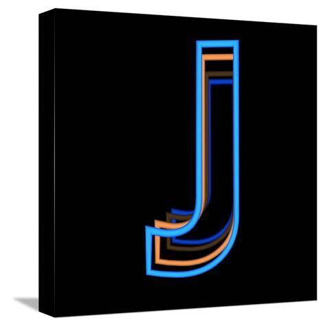 Glowing Letter J Isolated On Black Background-Andriy Zholudyev-Stretched Canvas Print