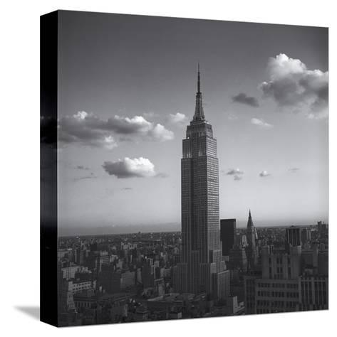 Empire State Building White Clouds - New York City Iconic Building, Top View-Henri Silberman-Stretched Canvas Print