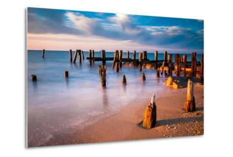Long Exposure at Sunset of Pier Pilings in the Delaware Bay at Sunset Beach, Cape May, New Jersey.-Jon Bilous-Metal Print