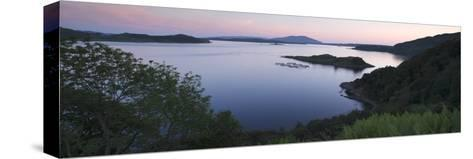 View over Seil Sound to a Salmon Farm and Luing, Slate Islands, Argyll and Bute, Scotland-Peter Thompson-Stretched Canvas Print
