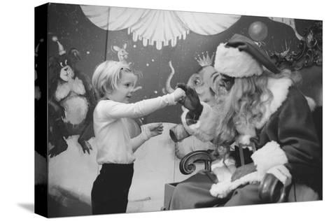 Boy Kissing African American Santa Claus in Unidentified Department Store. 1970-Ralph Morse-Stretched Canvas Print