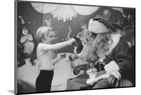 Boy Kissing African American Santa Claus in Unidentified Department Store. 1970-Ralph Morse-Mounted Photographic Print