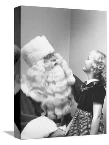 Santa Claus and 5 Year Old Demonstrating Right Way to Hold Child-Martha Holmes-Stretched Canvas Print