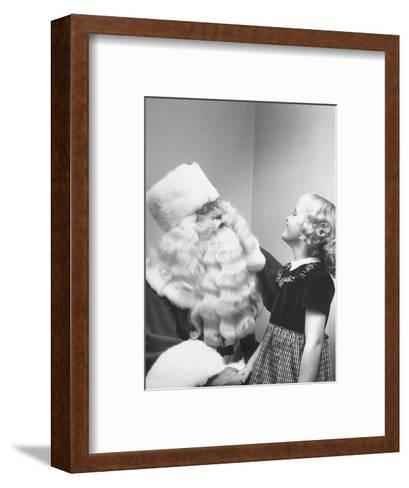 Santa Claus and 5 Year Old Demonstrating Right Way to Hold Child-Martha Holmes-Framed Art Print