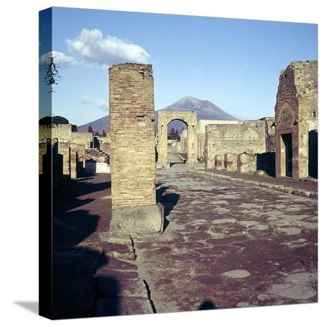 Road Leading to Arch of Caligula with Vesuvius Beyond, Pompeii, Italy-CM Dixon-Stretched Canvas Print