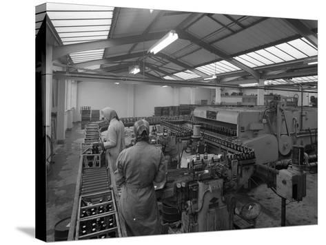 The Final Process of Bottling Beer, Ward and Sons Bottling Plant, Swinton, South Yorkshire, 1960-Michael Walters-Stretched Canvas Print