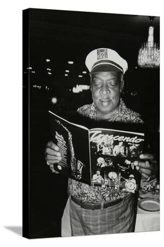 Count Basie Reading a Copy of Crescendo Magazine at the Grosvenor House Hotel, London, 1979-Denis Williams-Stretched Canvas Print
