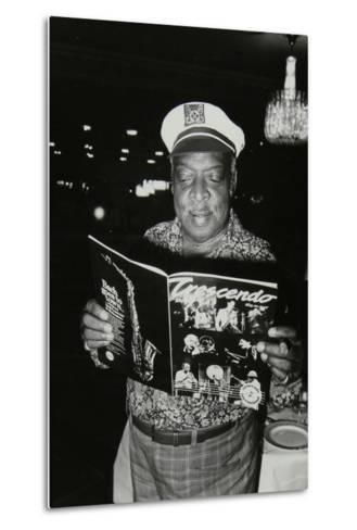 Count Basie Reading a Copy of Crescendo Magazine at the Grosvenor House Hotel, London, 1979-Denis Williams-Metal Print