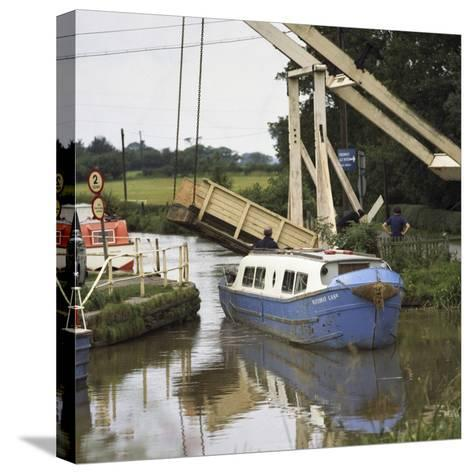 A Canal Boat Passing under a Lift Bridge on the Llangollen Canal, 1970-Michael Walters-Stretched Canvas Print