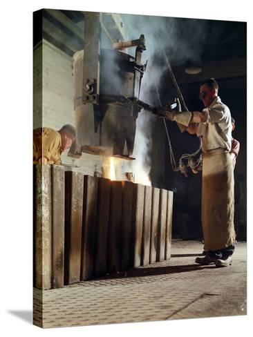 Teeming Iron into Ingots, J Beardshaw and Sons, Sheffield, South Yorkshire, 1963-Michael Walters-Stretched Canvas Print