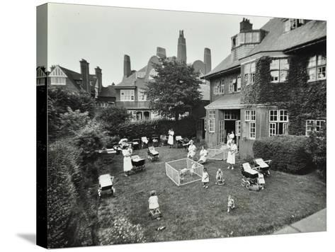 Children and Carers in a Garden, Hampstead, London, 1960--Stretched Canvas Print