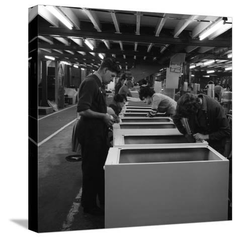 Fridge Assembly Line at the General Electric Company, Swinton, South Yorkshire, 1964-Michael Walters-Stretched Canvas Print