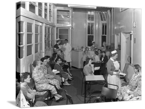 Outpatients Awaiting Treatement at the Montague Hospital, Mexborough, South Yorkshire, 1959-Michael Walters-Stretched Canvas Print