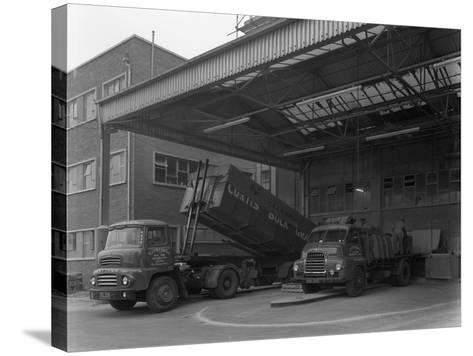Unloading and Loading Lorries, Spillers Animal Foods, Gainsborough, Lincolnshire, 1961-Michael Walters-Stretched Canvas Print