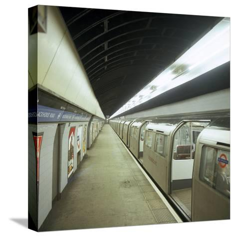 Tube Train Standing at Blackhorse Road Station on the Victoria Line, London, 1974-Michael Walters-Stretched Canvas Print