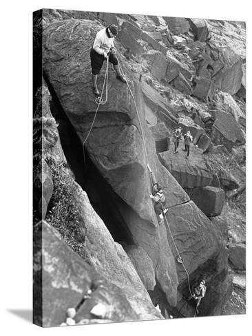 Climbers on Stanage Edge, Hathersage, Derbyshire, 1964-Michael Walters-Stretched Canvas Print