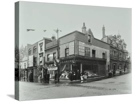 Shops and Sign to Putney Roller Skating Rink, Putney Bridge Road, London, 1911--Stretched Canvas Print