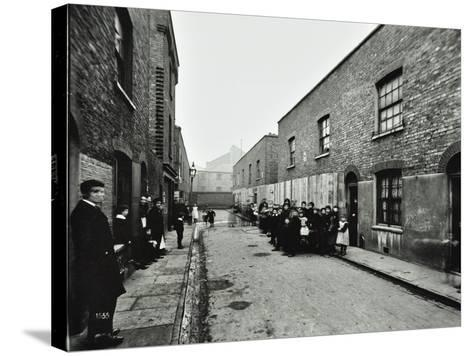People Outside Boarded-Up Houses in Ainstey Street, Bermondsey, London, 1903--Stretched Canvas Print